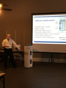 Buzz Thielemann  explaining the parts of a water heater and what potential problems to look for